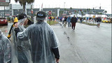 Slideshow: Fans disperse after race postponed - (8/10)