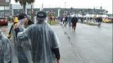 Slideshow: Fans disperse after race postponed - (8/10)