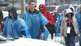 Slideshow: Fans disperse after race postponed - (9/10)