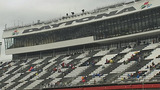 Slideshow: Fans disperse after race postponed - (3/10)