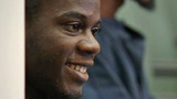 Photos: Shooting suspect laughs in court - (9/9)