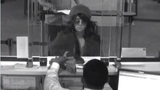 Detectives looking for cross-dressing bank… - (4/4)