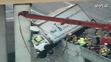 Photos: Truck dangles off I-95 overpass - (2/6)