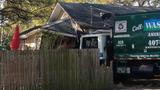 Photos: Trash truck smashes into Orlando home - (1/5)