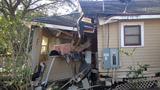 Photos: Trash truck smashes into Orlando home - (5/5)