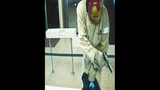 Photos: Man in 'Iron Man' mask robs bank - (4/5)