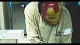 Photos: Man in 'Iron Man' mask robs bank - (1/5)