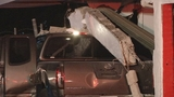 Photos: Pickup truck slams into tire shop - (8/8)