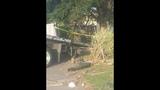 Photos: Car slams through house fence - (12/15)