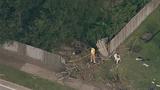 Photos: Car slams through house fence - (2/15)