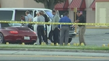 Photos: Deadly shooting in shopping plaza - (3/8)