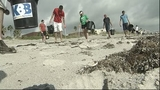 NASA workers clean up Cocoa Beach - (7/7)