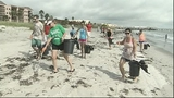 NASA workers clean up Cocoa Beach - (1/7)