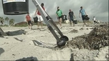 NASA workers clean up Cocoa Beach - (4/7)
