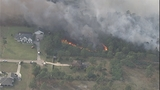 Photos: Brush fire threatens homes along I-95 - (17/20)