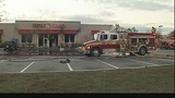 Photos: Crews battle Family Dollar fire - (8/11)