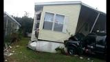 Photos: Pickup truck slams into home - (1/4)