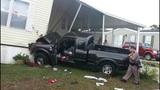 Photos: Pickup truck slams into home - (3/4)