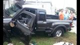 Photos: Pickup truck slams into home - (2/4)