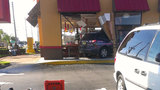 Photos: Car crashes into Popeyes restaurant - (4/18)