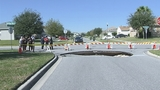 Photos: Clermont sinkhole closes street - (5/20)