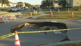 Photos: Clermont sinkhole closes street - (7/20)