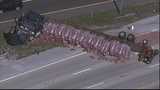 Photos: Truck with mulch overturns, blocking I-4 - (7/11)