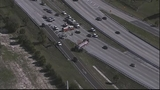 Photos: Truck with mulch overturns, blocking I-4 - (3/11)