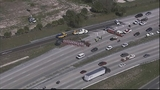 Photos: Truck with mulch overturns, blocking I-4 - (2/11)