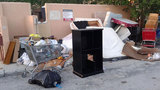 Photos: Massive trash pile outside apartments - (1/7)
