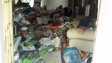 Photos: Home filled with trash catches fire - (5/7)