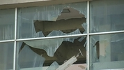 Crews started the demolition process of Cocoa Beach's glass bank Wednesday.