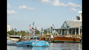 Guests go for a ride in a Captain-guided tour aboard an amphibious auto, known as an Amphicar, on Lake Buena Vista at Downtown Disney, as part of the waterfront adventures offered at The BOATHOUSE restaurant.