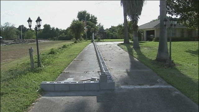 Neighbor Removes Cement Blocks From Osceola County Man S