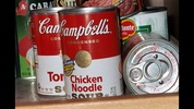 When preparing for a hurricane, focus on stocking non-perishable, ready-to-eat foods in singl- serving cans, like soups. High-energy foods such as peanut butter, granola bars and trail mix are recommended. Include canned beverages like juices and teas, as well as instant coffee and tea bags. Don't forget seasonings and other basic food staples, along with serving supplies like paper plates, cups, napkins and plastic utensils. If you have the room, pack coolers with ice to keep cold products safe for consumption for a longer period of time.