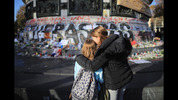 PARIS, FRANCE - NOVEMBER 15: People pause for thought at Place de la Republique as France observes three days of national mourning for the victims of the terror attacks on November 15, 2015 in Paris, France. As France observes three days of national mourning members of the public continue to pay tribute to the victims of Friday's deadly attacks. A special service for the families of the victims and survivors is to be held at Paris's Notre Dame Cathedral later on Sunday. (Photo by Christopher Furlong/Getty Images)
