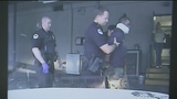 Raw: Dashcam shows suspect being punched (Warning: Graphic language)