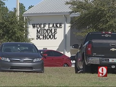 Teacher accused of ripping lollipop out of student