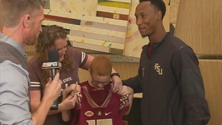 FSU football player who sat with autistic boy at lunch gives family game tickets