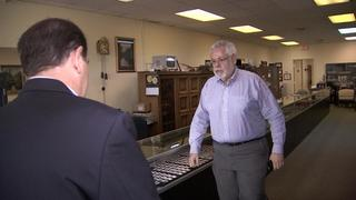 Action 9 confronts owner of collectible shop accused of cheating consumers