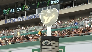 USF runs past UCF, 48-31