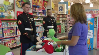 Shoppers donate to Toys for Tots as part of Giving Tuesday