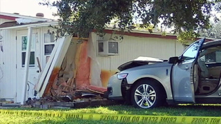 Police: Car crashes into Titusville home after gunman shoots at motorist