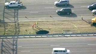 15-foot hole in I-4 median backs up traffic near World Drive