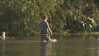Video: Some choose to stay after massive flooding on Little Wekiva Road