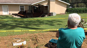 Homeowner watches as sinkhole swallows home in Apopka.