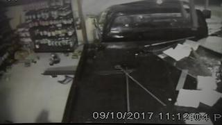 Raw: Man in stolen tow truck plows through Orange County store during Irma