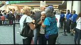 Raw Video: Families from Puerto Rico arrive at OIA