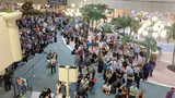 VIDEO: A camera battery explodes causing panic in an OIA terminal.