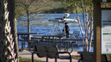 Divers pull plane wreckage from Lake Harney